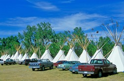 Tipis and trucks at Crow Fair - TOM BEAM