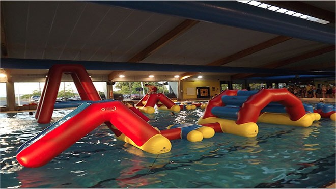 A new inflatable obstacle course is featured at Witter Pool this summer. - SPOKANE PARKS & RECREATION