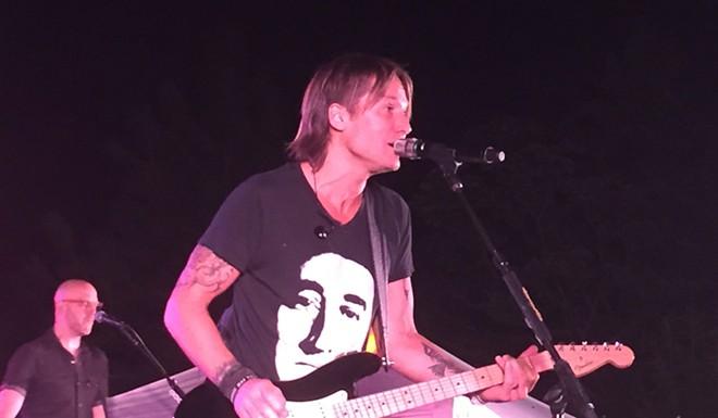 Keith Urban evokes his inner Steve Miller at a backyard benefit concert in Spokane. - JER MCGREGOR