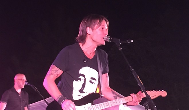 Keith Urban evokes his inner Steve Miller at a backyard benefit concert in Spokane. - JER MCGREGOR