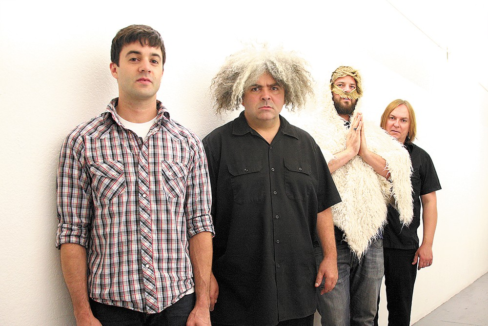 Buzz Osborne is the one with all the hair.