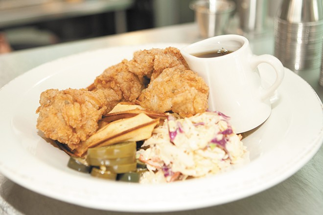 The Yards' most popular dish: chicken and waffles. - MEGHAN KIRK