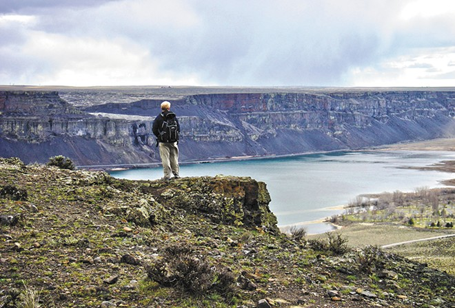 A Spokane Mountaineers member explores Steamboat Rock. - CAROL SMUCKER