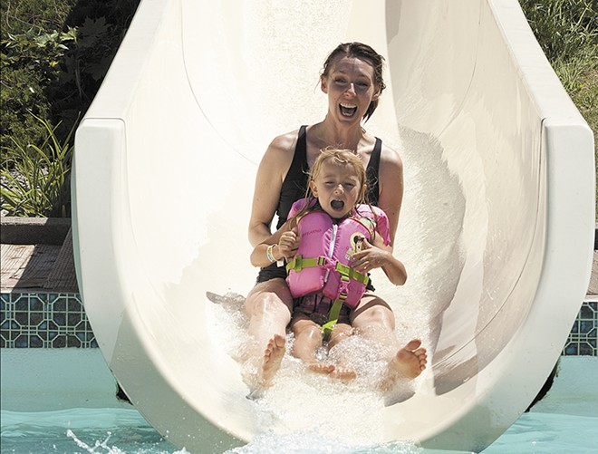 Sarah Keevy and her daughter Anna riding the slide together at Splashdown. - TIMOTHY PHILLIPS