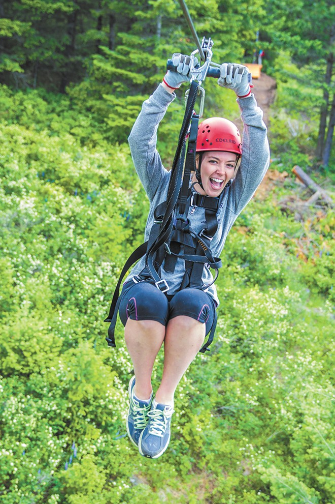 Laura Regester soaring down a zip line. (below) A tour (above) at Mica Moon. - ROD JEFFERS PHOTOS