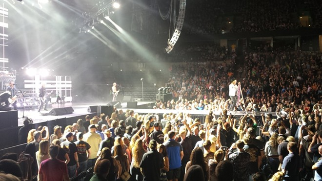 A catwalk jutting into the crowd on the arena floor got the band closer to its fans. - DAN NAILEN
