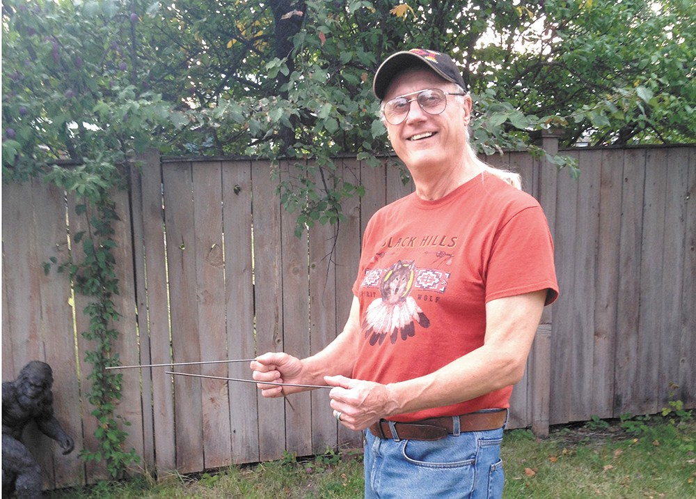 Kewaunee Lapseritis with his dowsing rods.