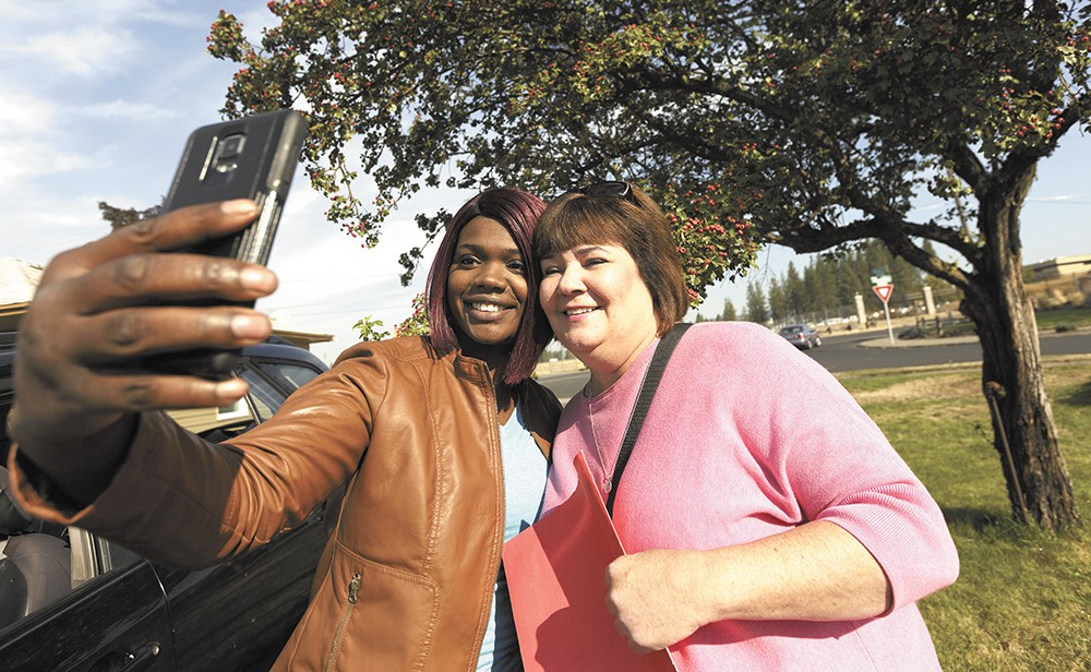 Spokane City Councilwoman Karen Stratton (right) takes a break from campaigning to snap a selfie with local activist Kitara Johnson. - YOUNG KWAK