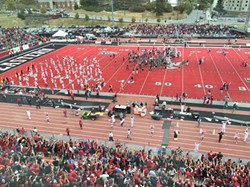 The EWU Eagles celebrate on the field after a 42-41 overtime victory against the Cal Poly Mustangs - MAX CARTER