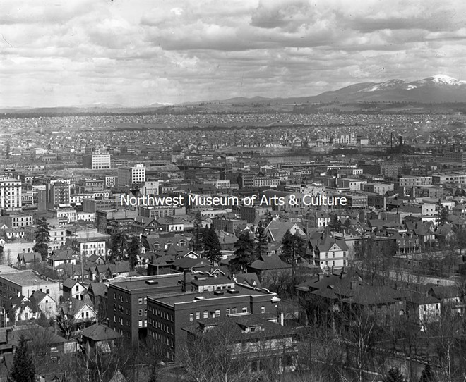 A bird's eye view of Spokane, looking northeast from Cliff Avenue, in 1911. From the Frank Palmer Collection. The two buildings in the foreground are still standing, on the corner of Stevens and Seventh Avenue, near the existing Edwidge Woldson Park. - MAC