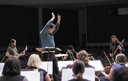 SFCC Chorale Director Nathan Lansing conducts the school's symphony orchestra in its collaboration with local band Age of Nefilim. - YOUNG KWAK