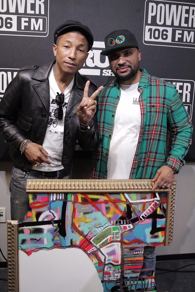 Pharrell (left) with Joyce's buddy Vinrican.