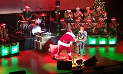 Santa showed up to dance, despite working all the previous night. - DAN NAILEN