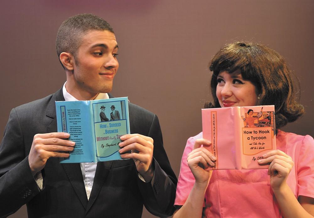 Ilan Hernandez (left) as J. Pierpont Finch and Julian Lee as Rosemary Pilkington.