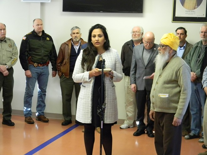 Subarna Nagra, a member of the Sikh Temple of Spokane, gathered with community leaders to condemn an act of vandalism against the house of worship. - JAKE THOMAS
