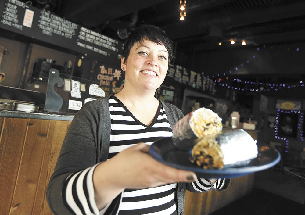 Co-owner Patty Tully shows off a signature burrito. - KRISTEN BLACK