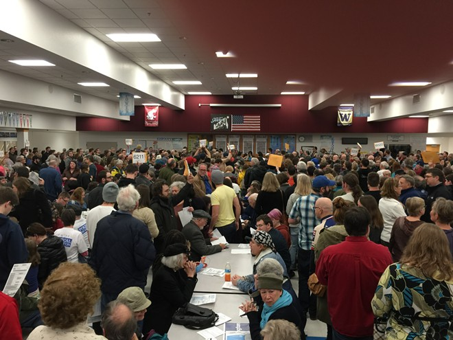 The scene inside Chase Middle School for the Democratic caucus. - TED S. MCGREGOR JR.