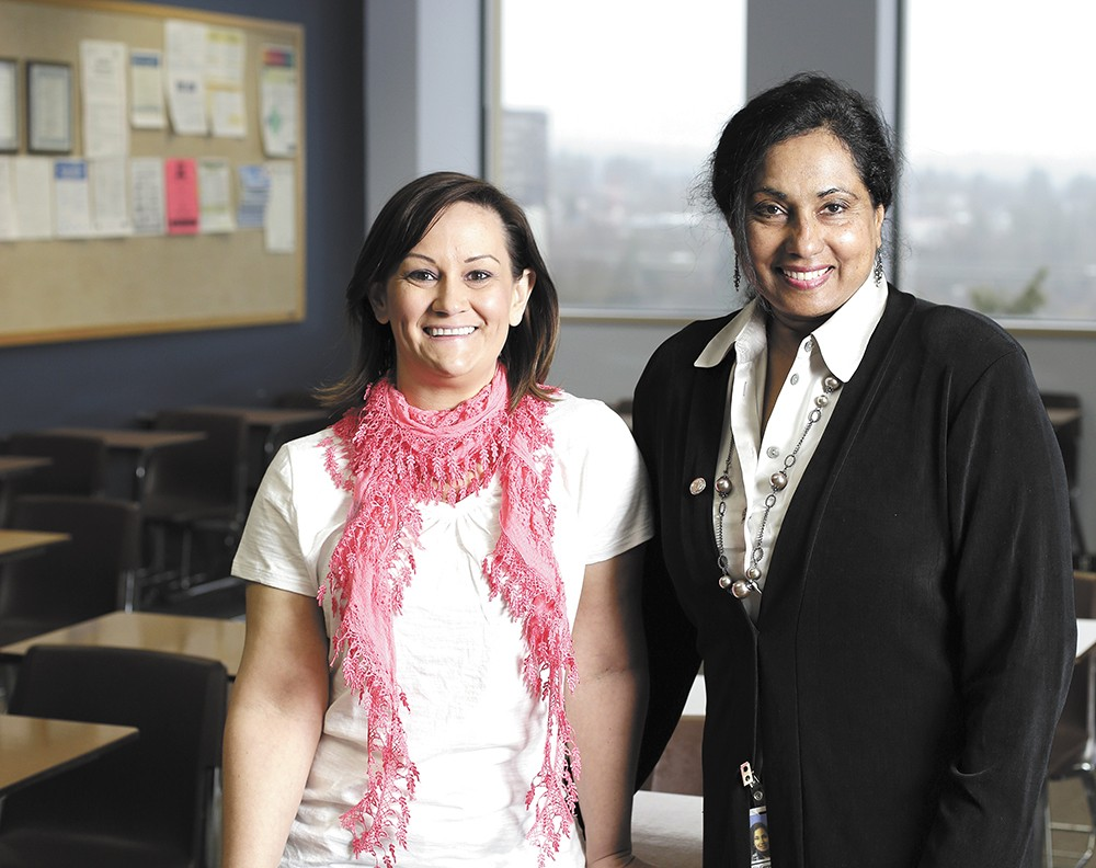 Chief Examiner Gita George-Hatcher (right) and Nicole Goes, an analyst with the civil service department, say the city of Spokane is searching for ways to hire more women. - YOUNG KWAK