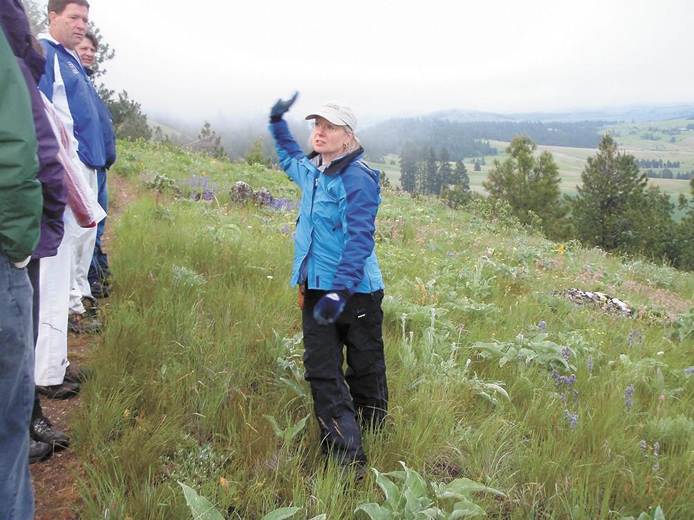 Jacie Jensen leads a tour of native plant species of the Palouse. - TRISH HEEKIN PHOTO