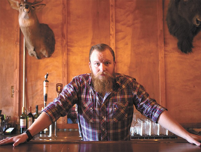 Beerocracy owner Tyler Riggs brings a wealth of beer knowledge to the new pub in the Garland neighborhood. - TESS FARNSWORTH