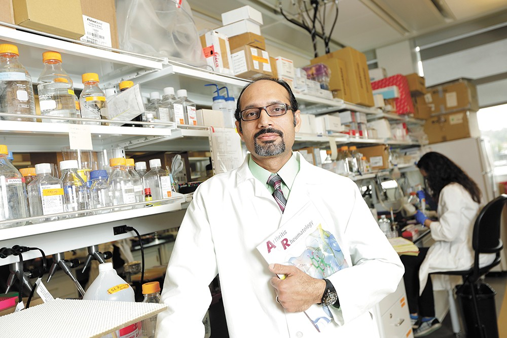"Salah-uddin Ahmed in his WSU Spokane lab: ""You're always on the edge when you're in science."" - YOUNG KWAK"