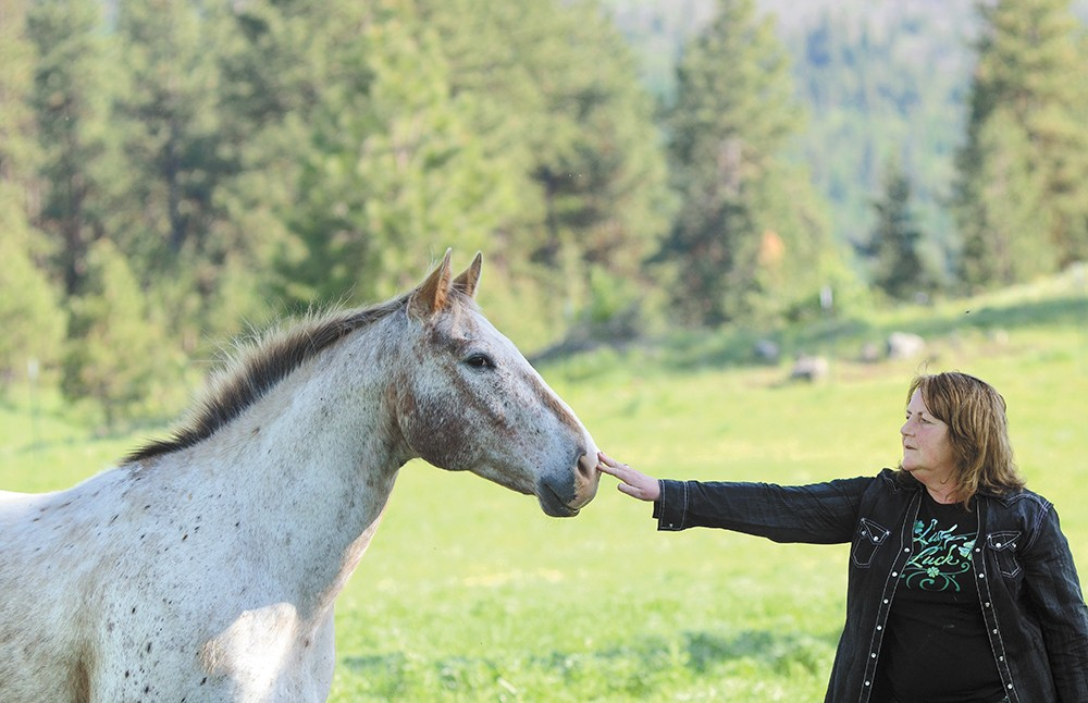 Mary Ciais on the family ranch in May. Of all their horses, Splash was one Rafe particularly liked, both sharing distinctive white hair. - MIKE SALSBURY