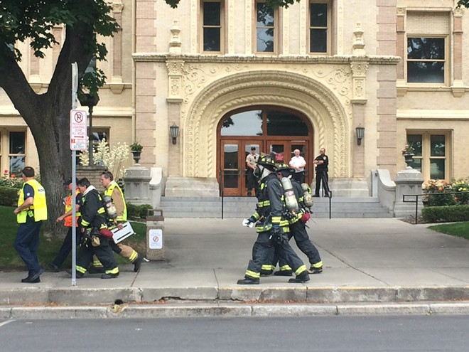 Spokane firefighters outside the evacuated Spokane County Courthouse - MITCH RYALS PHOTO