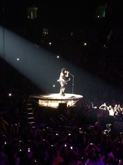 """KISS co-founder Paul Stanley flew to middle of the arena to sing """"Love Gun."""" He later asked, """"Who wants to see my love gun?"""""""