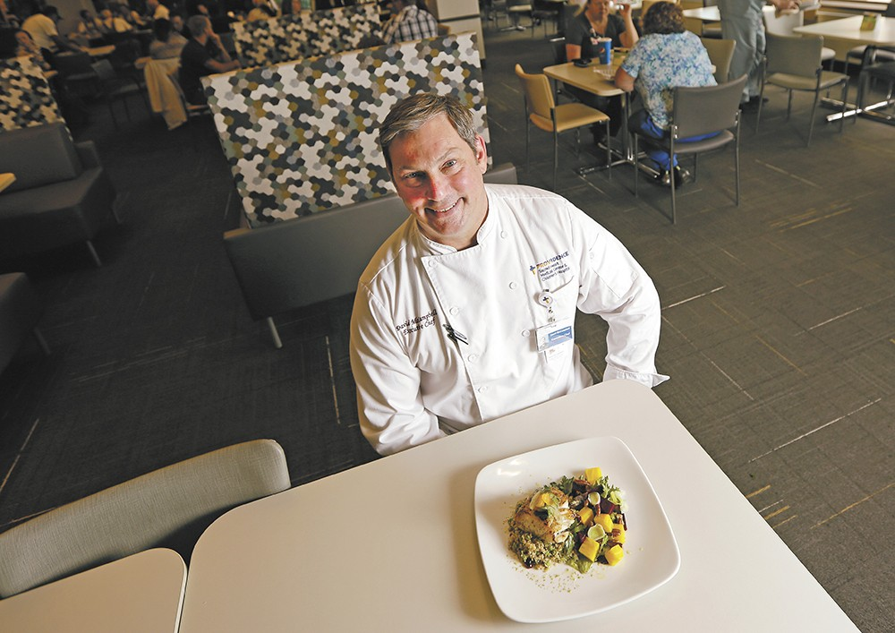 """Chef David McCampbell in the Sacred Heart dining room with his grilled halibut: """"I want to make the healthy option, the easy option."""" - YOUNG KWAK"""