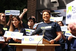 April Sims, signature drive director for Raise Up Washington, Olympia helped the group turn in more than 340,000 signatures to qualify I-1433 for the ballot in July - PHOTO COURTESY OF RAISE UP WASHINGTON