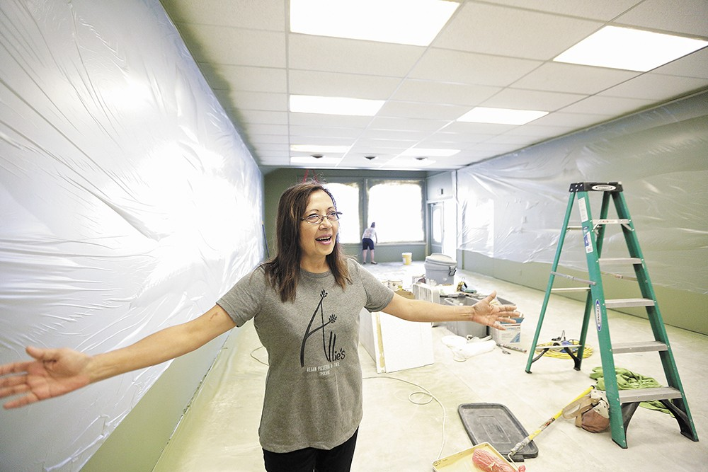 Atania Gilmore shows off the new Allie's Vegan Pizzeria & Cafe space on the South Hill. - YOUNG KWAK