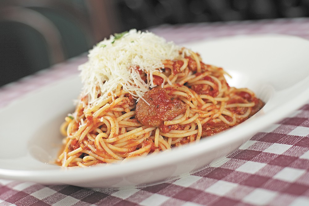 An order of Sardinia Old Fashioned spaghetti is heaped on a plate at Luigi's. - YOUNG KWAK
