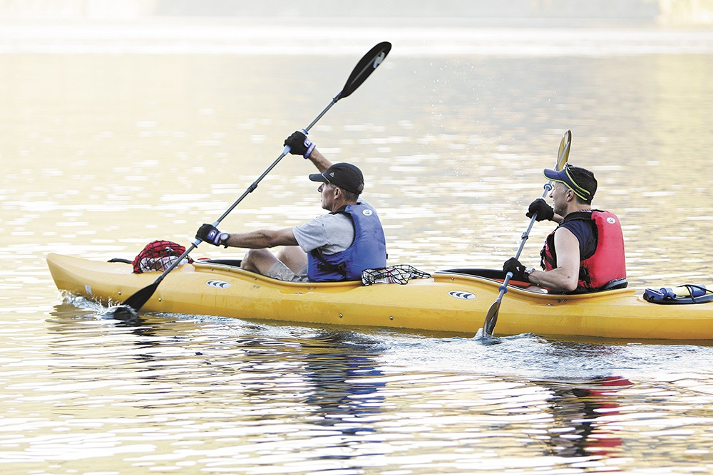 Scott Janetzy, left, and Ray Honovich take to the water at Farragut State Park. - YOUNG KWAK