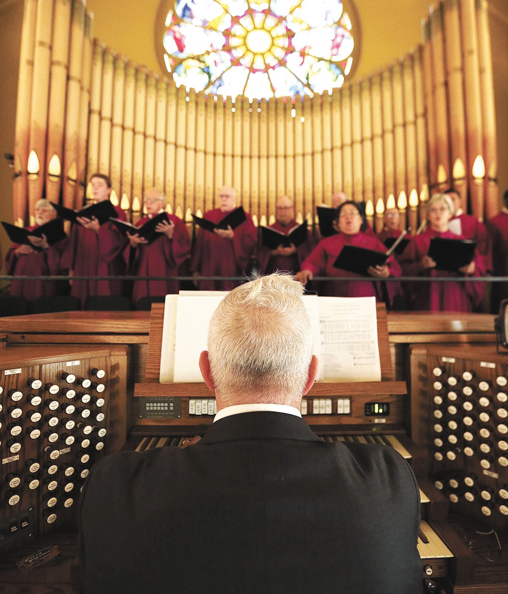 Organist Keith Thomas accompanies the Cathedral of Our Lady of Lourdes choir during mass last weekend. - YOUNG KWAK