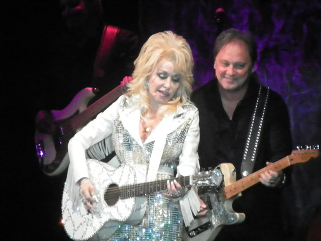 Parton's long nails didn't keep her from doing some mean guitar-playing. - DAN NAILEN