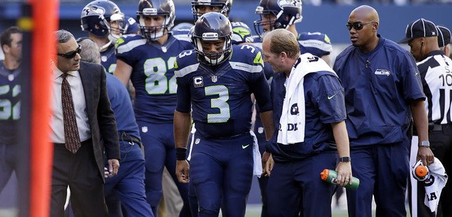 Russell Wilson was a little gimpy after injuring his knee Sunday. - SEAHAWKS.COM