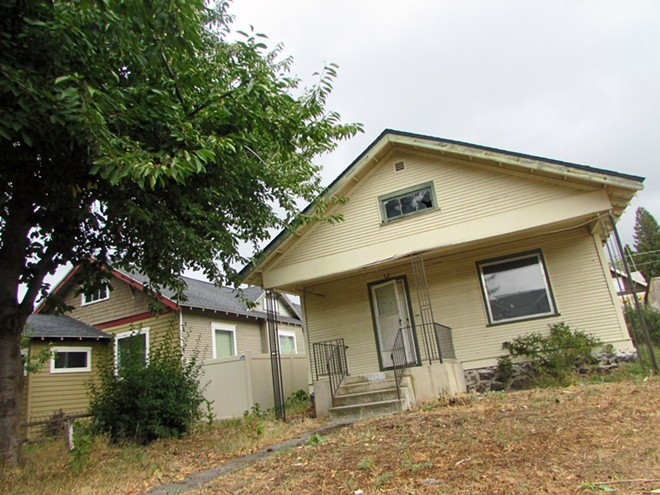 This house, owned by the City of Spokane CFO, has been vacant for years. He's planning on either selling it or rehabbing it next year. - DANIEL WALTERS PHOTO
