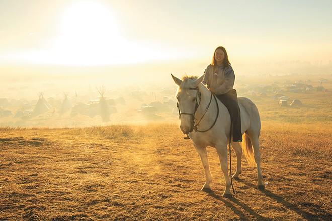 Tracy Hsu from Elgin, North Dakota, and her horse Ashley. - JEFF FERGUSON