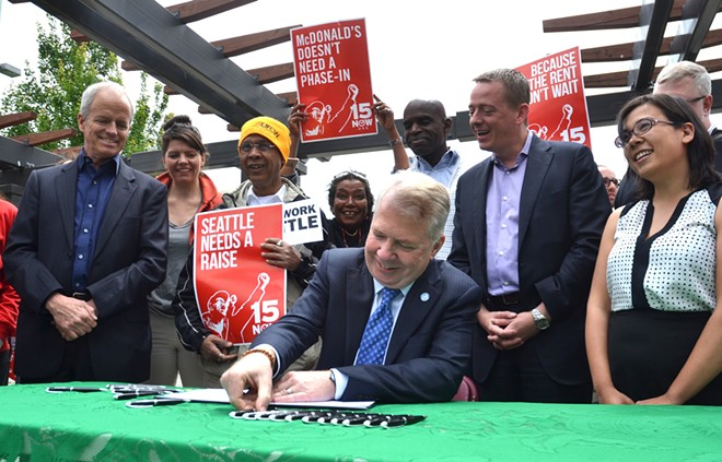 Seattle Mayor Ed Murray signs a bill to gradually increase Seattle's minimum wage to $15 in 2014. - SEATTLE.GOV