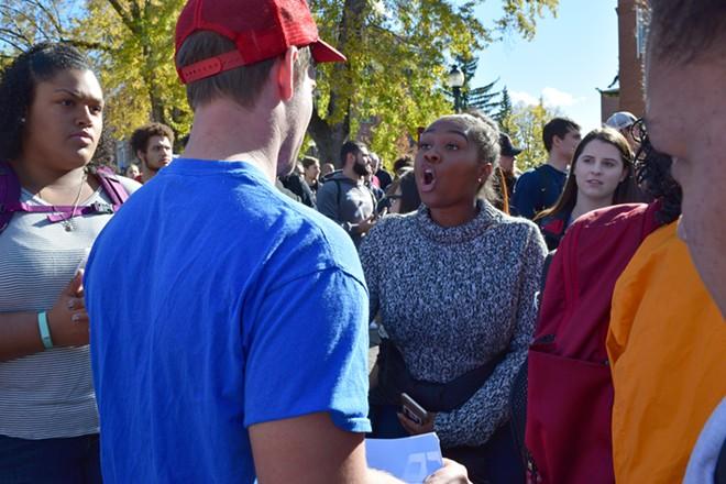 Lashae Daniels, right, confronts a Trump supporter. - TAEHLOR CRIM / MURROW NEWS SERVICE PHOTOS