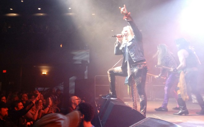 "The ""devil horns"" flew early and often at Steel Panther's show Thursday. - DAN NAILEN"
