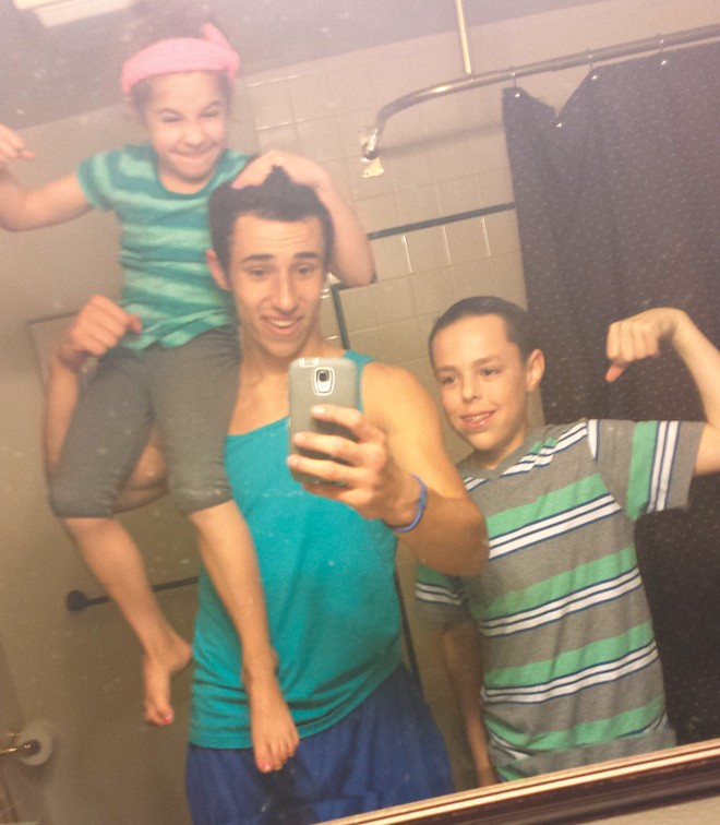 Isaiah and his younger siblings take a selfie. - FACEBOOK