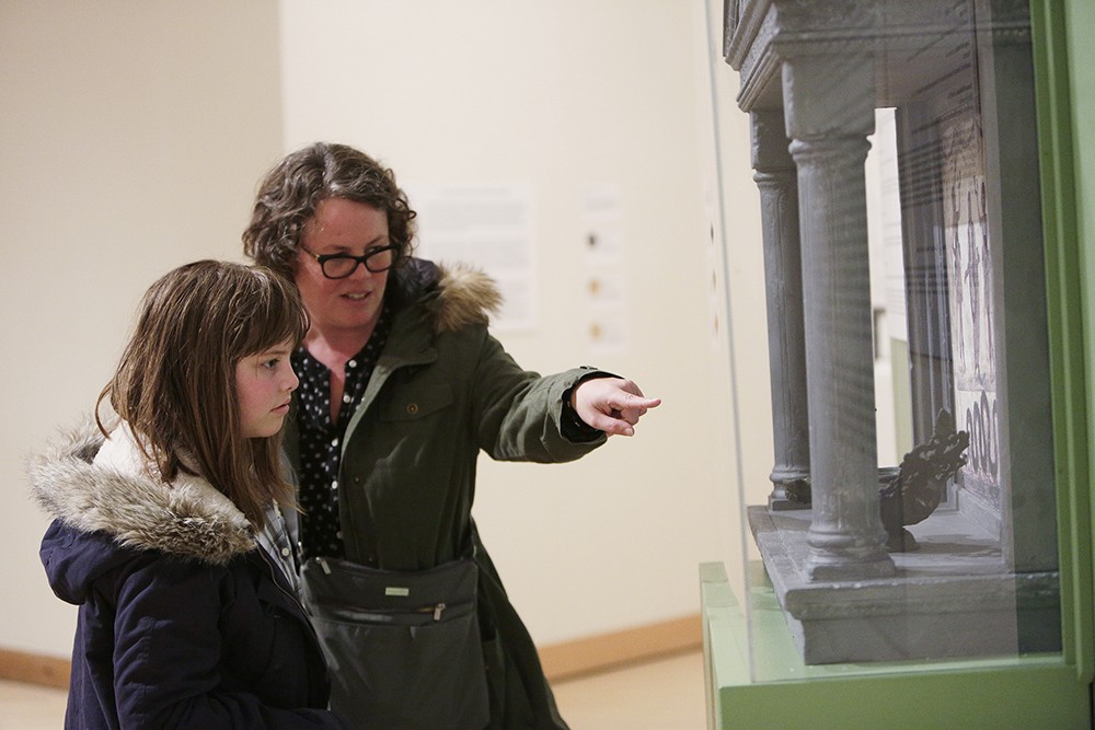 Liana Krissoff and her daughter Thaila, both visiting from West Virginia, look at a lararium, a Roman household shrine. - YOUNG KWAK