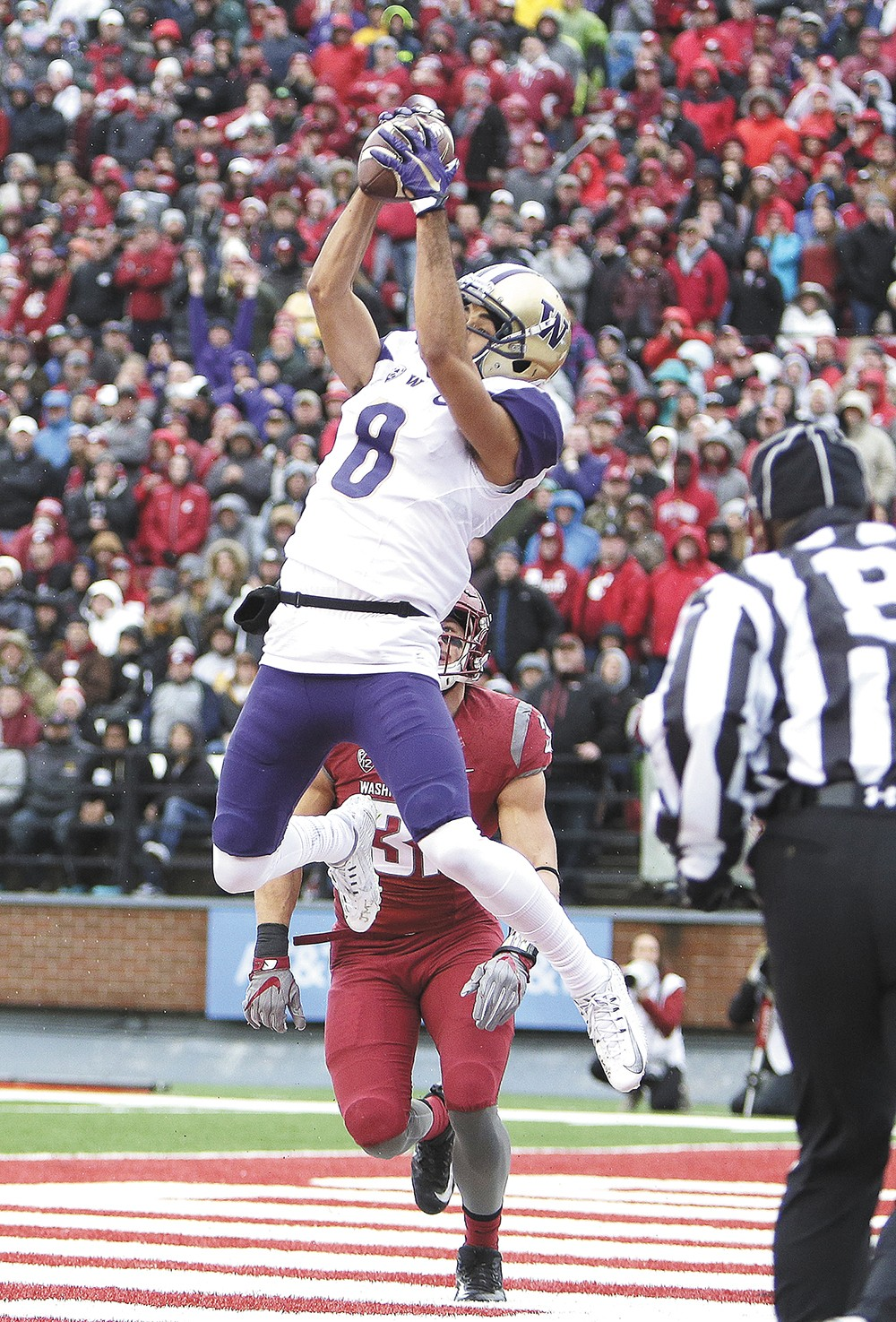 UW's Dante Pettis hauls in one of his two touchdowns. - YOUNG KWAK