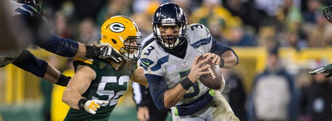 Russell Wilson was better off holding the ball than throwing it on Sunday. - SEAHAWKS.COM