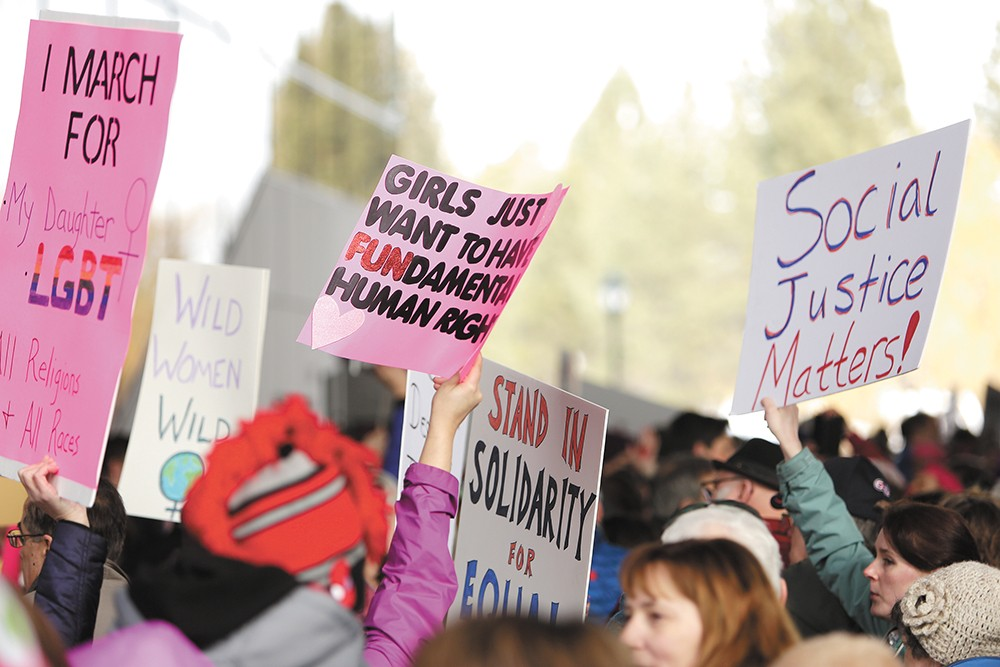 Signs proved a widely shared aspect of the day's marches around the world. - YOUNG KWAK