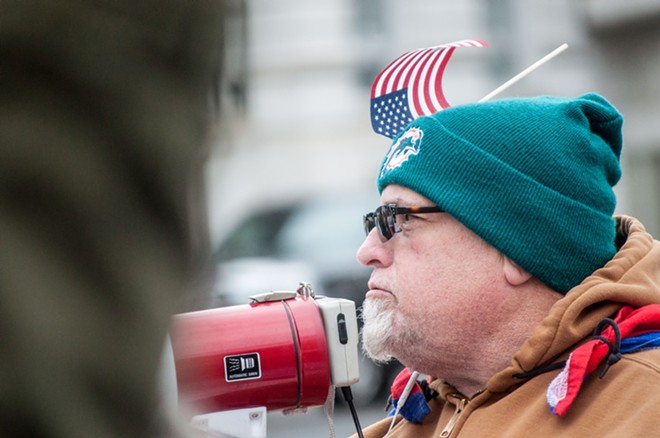 Frequent activist Alfredo LLamedo speaks from the bullhorn. - DANIEL WALTERS PHOTO