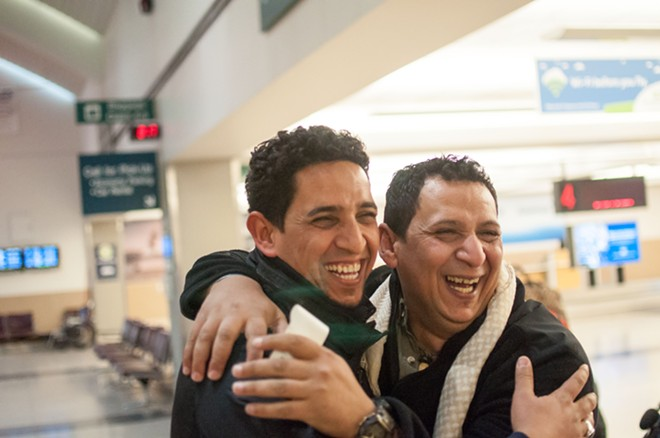 Hamid Nahi and his brother Assad Al-Sawaedi laugh about the ways they used to tease each other growing up in Iraq. - DANIEL WALTERS PHOTO
