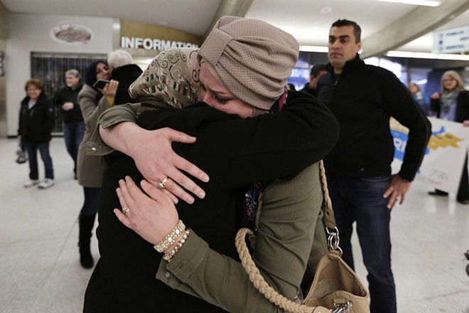 Hamas Fahan, right, hugs her mother-in-law Montaha Jawad, a refugee from Iraq. - YOUNG KWAK PHOTO