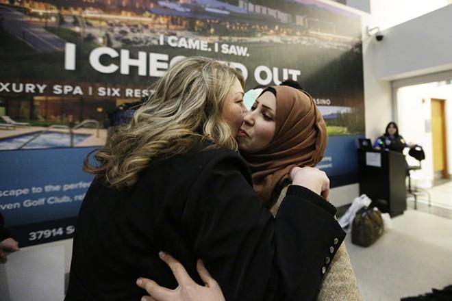 Christina Lamb, left, hugs her future sister-in-law Raghad Al-Sawaedi. - YOUNG KWAK PHOTO